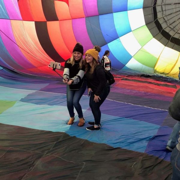 Two young ladies taking a selfie in the hot air balloon